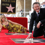 Actors Russell and Goldie Hawn pose on their stars after being unveiled on the Hollywood Walk of Fame in Los Angeles